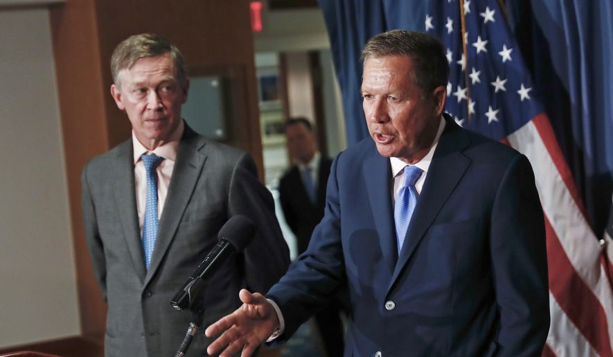 In this June 27, 2017, file photo, Ohio Gov. John Kasich, right, joined by Colorado Gov. John Hickenlooper, left, speaks during a news conference at the National Press Club in Washington. (AP Photo/Carolyn Kaster, File)