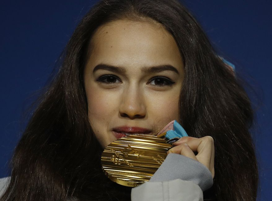 Gold medalist in the women's free figure skating Russian athlete Alina Zagitova poses during the medals ceremony at the 2018 Winter Olympics in Pyeongchang, South Korea, Friday, Feb. 23, 2018. (AP Photo/Charlie Riedel)
