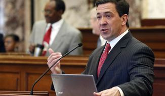 "Sen. Chris McDaniel, R-Ellisville, speaks about one of his amendments during floor debate to the creation of the Asbestos Transparency Trust Act in Senate chambers at the Capitol in Jackson, Miss.. McDaniel, who lost a bitter U.S. Senate race in 2014, says he will ""get into a dark place and pray"" about whether to run this year. (AP Photo/Rogelio V. Solis, File)"