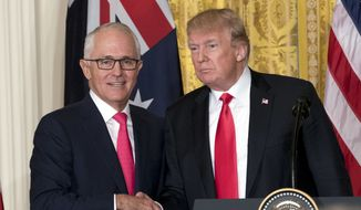 President Donald Trump and Australian Prime Minister Malcolm Turnbull shake hands following a joint news conference in the East Room of the White House in Washington, Friday, Feb. 23, 2018. (AP Photo/Andrew Harnik)