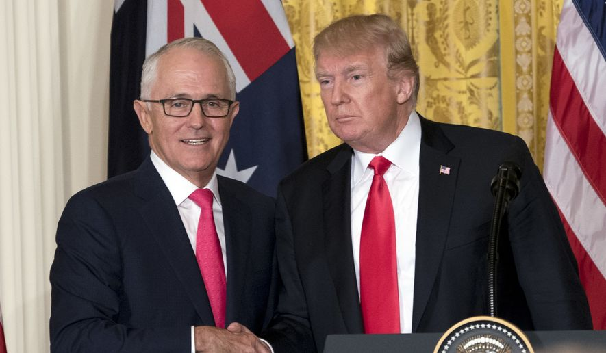President Donald Trump and Australian Prime Minister Malcolm Turnbull shake  hands following a joint news conference