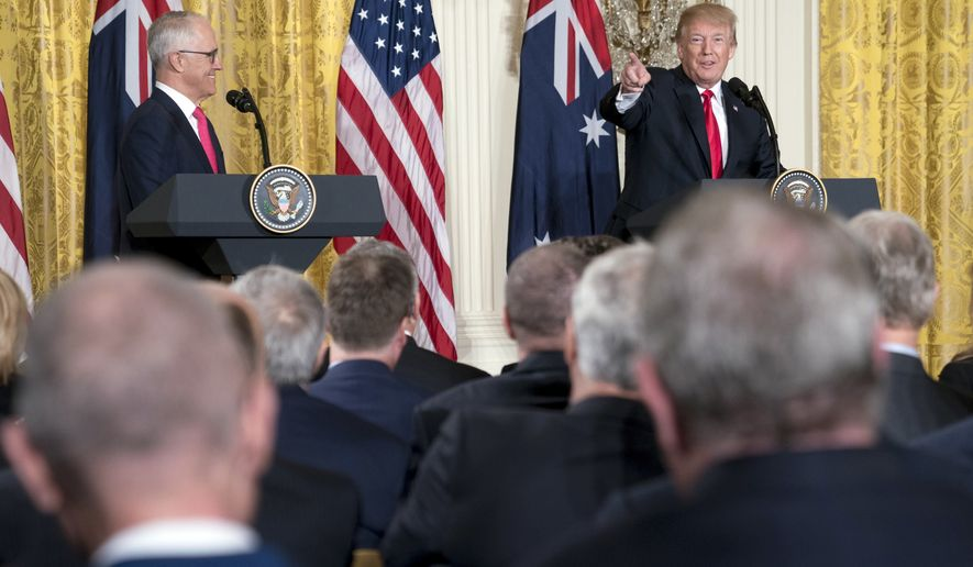 President Donald Trump, accompanied by Australian Prime Minister Malcolm Turnbull, left, speaks during a joint news conference in the East Room of the White House in Washington, Friday, Feb. 23, 2018. (AP Photo/Andrew Harnik)