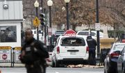 A Secret Service officer checks a white passenger vehicle that struck a security barrier a the southwest entrance to the White House grounds off of 17th Street n Washington, Friday, Feb. 23, 2018. (AP Photo/J. Scott Applewhite)