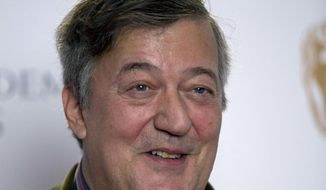 FILE - In this Friday, Jan. 9, 2015 file photo, British actor and comedian Stephen Fry poses for photographers during a photocall to mark the announcement of the BAFTA (British Academy of Film and Television Arts) award nominations in London. British comedian and actor Stephen Fry has revealed that he is suffering from prostate cancer. The 60-year-old Fry said Friday Feb. 23, 2018  on his Twitter page that he has been fighting the disease for the past two months. (AP Photo/Matt Dunham, File)
