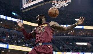 Cleveland Cavaliers forward LeBron James dunks during the first half of the team's NBA basketball game against the Memphis Grizzlies on Friday, Feb. 23, 2018, in Memphis, Tenn. (AP Photo/Brandon Dill)