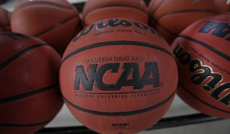 "FILE - In this March 22, 2010, file photo, basketballs are seen before Northern Iowa's NCAA college basketball practice, in Cedar Falls, Iowa. Bank records and other expense reports that are part of a federal probe into college basketball list a wide range of impermissible payments from agents to at least two dozen players or their relatives, according to documents obtained by Yahoo Sports. NCAA president Mark Emmert said in a statement Friday, Feb. 23, 2018, the allegations ""if true, point to systematic failures that must be fixed and fixed now if we want college sports in America."" (AP Photo/Charlie Neibergall, File)"