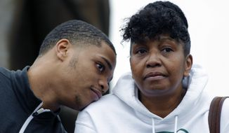 FILE - In this April 13, 2017, file photo, Michigan State's Miles Bridges, left, rests his on the shoulder of his mother, Cynthia, during an NCAA college basketball news conference in East Lansing, Mich. Bank records and other expense reports that are part of a federal probe into college basketball list a wide range of impermissible payments from agents to at least two dozen players or their relatives, including Bridges and his mother, according to documents obtained by Yahoo Sports. Such payments would be a violation of NCAA rules. (AP Photo/Al Goldis, File)