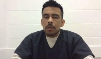In this undated still image taken from video, Jesus Chavez Flores is shown during an interview at the Northwest Detention Center in Tacoma, Wash. A new federal lawsuit claims that Flores was beaten and placed in solitary confinement because of his role in a hunger strike at the center. The Washington state chapter of the American Civil Liberties Union on Friday, Feb. 23, 2018, sued U.S. Immigration and Customs Enforcement as well as GEO Group, which operates the center. (Northwest Detention Center Resistance/via AP)