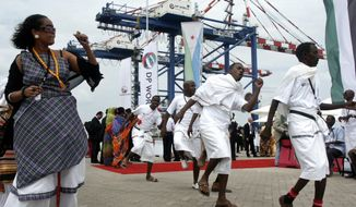 In this Feb. 7, 2009 file photo, Djibouti men and women dance during the opening ceremony of Dubai-based port operator DP World's Doraleh container terminal in Djibouti port. Djibouti has seized control of the terminal run by DP World, the latest move in a long-running legal dispute between the East African nation and DP World over the facility. (AP Photo/Adam Schreck, File)