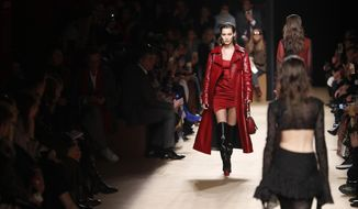 Model Bella Hadid wears a creation as part of the Roberto Cavalli women's Fall/Winter 2018-2019 collection, presented during the Milan Fashion Week, in Milan, Italy, Friday, Feb. 23, 2018. (AP Photo/Antonio Calanni)