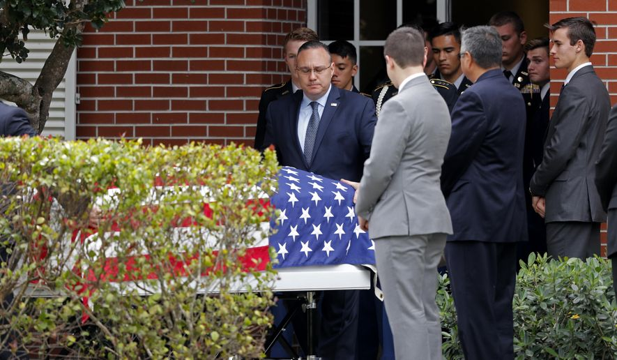 FILE - In this Feb. 19, 2018 file photo, the casket of Alaina Petty, a victim of the shooting at Marjory Douglas Stoneman High School, leaves her funeral in Coral Springs, Fla. A viral online video claimed victims of the shooting are fictitious because their birth records don't appear on a genealogy web site, but Ancestry says it has no birth records from the state. (AP Photo/Gerald Herbert, File)