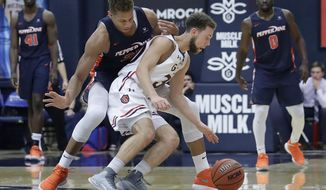 Saint Mary's guard Jordan Ford, center right, retrieves the ball in front of Pepperdine forward Kameron Edwards during the second half of an NCAA college basketball game in Moraga, Calif., Thursday, Feb. 22, 2018. (AP Photo/Jeff Chiu)