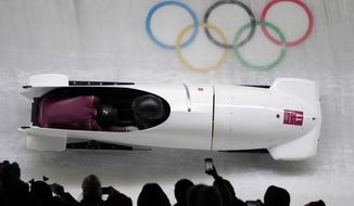 Driver Nadezhda Sergeeva and Anastasia Kocherzhova of the Olympic Athletes of Russia take a curve in their third heat during the women's two-man bobsled final at the 2018 Winter Olympics in Pyeongchang, South Korea, Wednesday, Feb. 21, 2018. (AP Photo/Michael Sohn)
