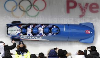 Driver Loic Costerg, Vincent Castell, Dorian Hauterville and Vincent Ricard of France take a curve in the second heat of the four-man bobsled competition at the 2018 Winter Olympics in Pyeongchang, South Korea, Saturday, Feb. 24, 2018. (AP Photo/Michael Sohn)
