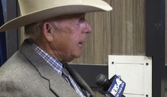 Southern Nevada rancher Cliven Bundy talks to a reporter before giving the keynote address to the state convention of the Independent American Party of Nevada Friday, Feb. 23, 2018, in Sparks, Nev. Bundy served 700 days in jail before a U.S. judge in Las Vegas threw out the criminal charges against him and others last month stemming from an armed standoff with federal agents at his ranch near Bunkerville in April 2014. (AP Photo/Scott Sonner)