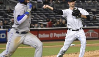 FILE - In this April 8, 2015, file photo, New York Yankees pitcher Chris Martin throws out Toronto Blue Jays' Jose Reyes during the seventh inning of a baseball game at Yankee Stadium in New York. Martin, now with the Texas Rangers, went to Arlington High School, not far from Globe Life Park. (AP Photo/Bill Kostroun, File)