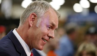 In this Feb. 9, 2018, file photo, U.S. Interior Secretary Ryan Zinke speaks to reporters at a conservation announcement at the Western Conservation and Hunting Expo in Salt Lake City. (AP Photo/Rick Bowmer, File) **FILE**