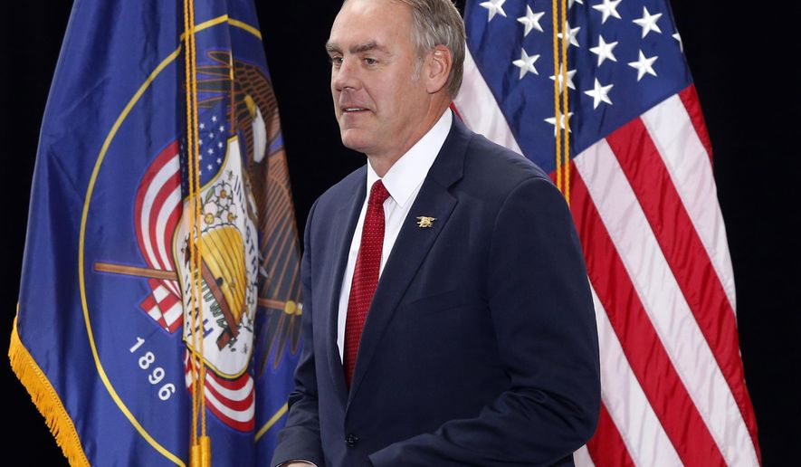 FILE - In this Dec. 4, 2017, file photo, Interior Secretary Ryan Zinke takes the stage before President Donald Trump speaks at the Utah State Capitol in Salt Lake City. On Friday, Feb. 23, 2018, Zinke will announce he will revise proposed new regional boundaries for the Interior Department as part of a major reorganization of the agency. The new boundaries would more closely follow state lines, a change from his earlier proposal, which largely ignored state boundaries and relied mostly on rivers and other natural features. (AP Photo/Rick Bowmer, File)