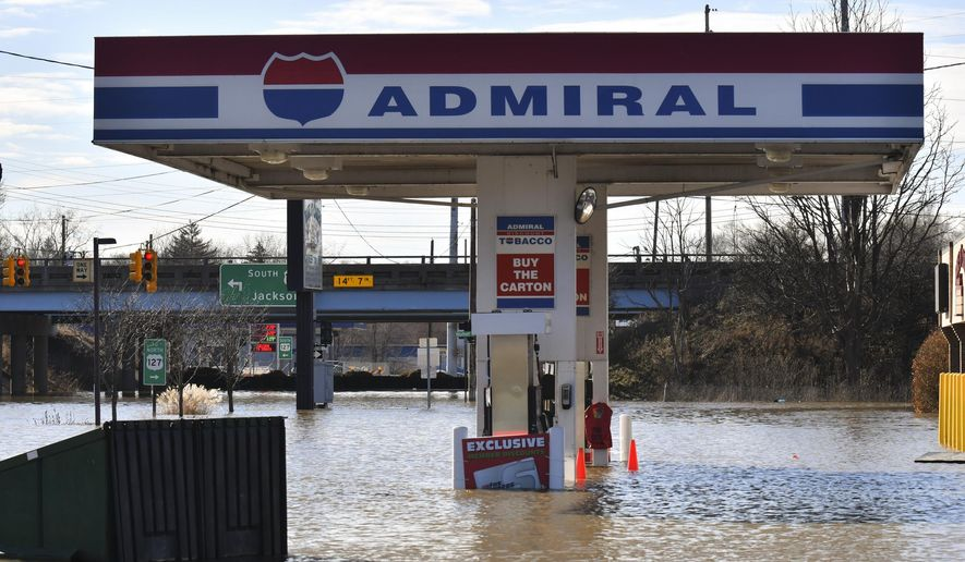 The Admiral gas station is under water from flooding Thursday, Feb. 22, 2018, in Lansing, Mich.  Flooding is expected to continue through the weekend in Michigan, Indiana and other Midwest states that have been swamped by high water from heavy rains and melting snow. (Matthew Dae Smith/Lansing State Journal via AP)