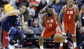 Houston Rockets guard James Harden (13) chases down the ball in front of Minnesota Timberwolves forward Nemanja Bjelica, left, as Rockets forward PJ Tucker (4) watches during the second half of an NBA basketball game Friday, Feb. 23, 2018, in Houston. (AP Photo/Michael Wyke)