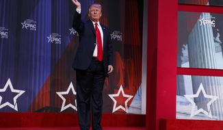 President Donald Trump waves after delivering remarks to the Conservative Political Action Conference, Friday, Feb. 23, 2018, in Oxon Hill, Md. (AP Photo/Evan Vucci)
