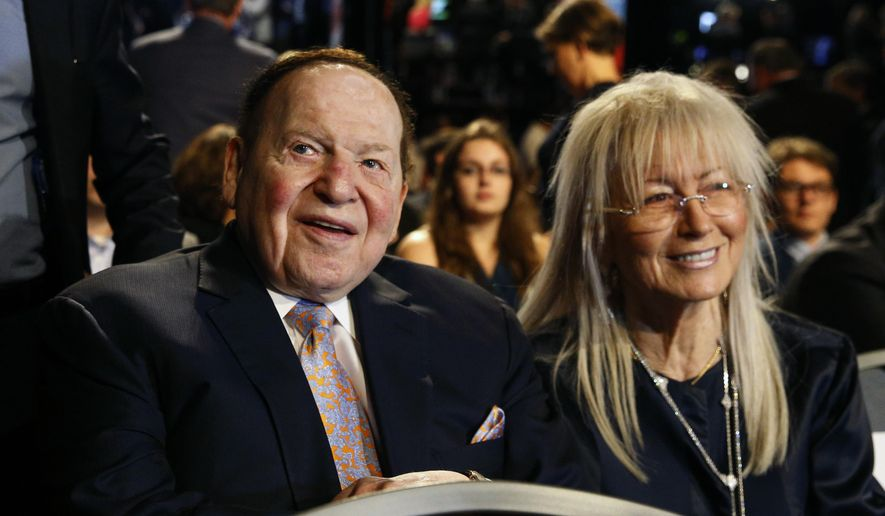 In this Sept. 26, 2016, file photo, Chief Executive of Las Vegas Sands Corp. Sheldon Adelson sits with his wife Miriam waits for the presidential debate between Democratic presidential nominee Hillary Clinton and then-Republican presidential nominee Donald Trump at Hofstra University in Hempstead, N.Y. (AP Photo/Patrick Semansky, File)