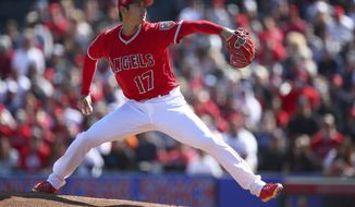 Los Angeles Angels' Shohei Ohtani works against the Milwaukee Brewers during the first inning of a spring training baseball game on Saturday, Feb. 24, 2018, in Tempe, Ariz. (AP Photo/Ben Margot) **File**