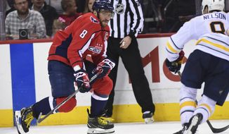 Washington Capitals left wing Alex Ovechkin takes the puck past Buffalo Sabres defenseman Casey Nelson, right, during the third period of an NHL hockey game in Washington, Saturday, Feb. 24, 2018. Ovechkin had two goals as the Capitals won 5-1. (AP Photo/Susan Walsh) **File**
