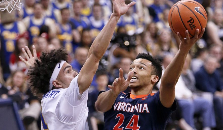 Virginia's Marco Anthony (24) shoots as Pittsburgh's Parker Stewart (1) defends during the second half of an NCAA college basketball game, Saturday, Feb. 24, 2018, in Pittsburgh. Virginia won 66-37. (AP Photo/Keith Srakocic) ** FILE **