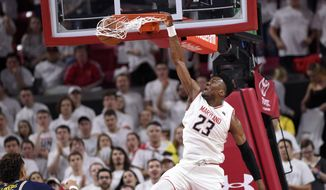 Maryland forward Bruno Fernando (23) dunks against Michigan forward Isaiah Livers (4) during the first half of an NCAA college basketball game, Saturday, Feb. 24, 2018, in College Park, Md. (AP Photo/Nick Wass) ** FILE **