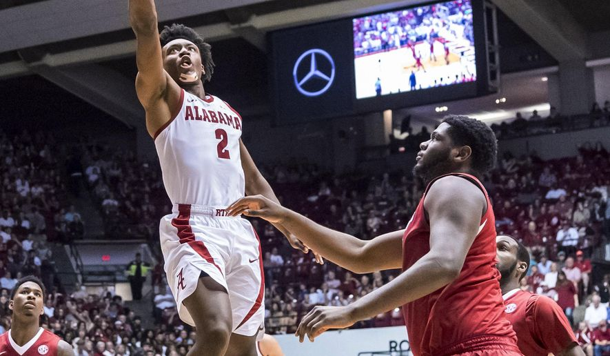Alabama guard Collin Sexton (2) shoots against Arkansas during an NCAA college basketball game Saturday, Feb. 24, 2018, in Tuscaloosa, Ala. (Vasha Hunt/AL.com via AP)
