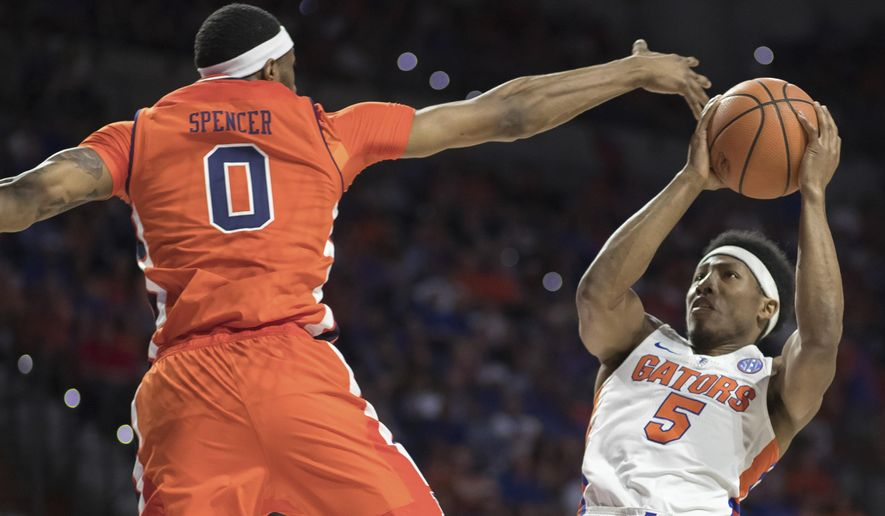 Florida guard KeVaughn Allen (5) shoots over Auburn forward Horace Spencer (0) during the first half of an NCAA college basketball game in Gainesville, Fla., Saturday, Feb. 24, 2018. (AP Photo/Ron Irby)