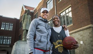 In a Sunday, Feb. 11, 2018 photo, Lincoln's Kondalia Montgomery, right, stands for a portrait with her sister, WNBA player Alex Montgomery outside Lincoln High School in Tacoma, Wash. Kondalia is a senior this season and was recently selected as the 3A Pierce County League most valuable player, following in the league-MVP footsteps of Alex. (Joshua Bessex/The News Tribune via AP)