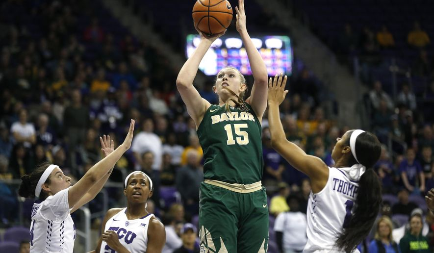 Baylor forward Lauren Cox (15) shoots over TCU defenders Amber Ramirez, left, Sydney Coleman (21), and Toree Thompson (1) during the first half of an NCAA college basketball game, Saturday, Feb. 24, 2018 in Fort Worth, Texas. (AP Photo/Ron Jenkins)