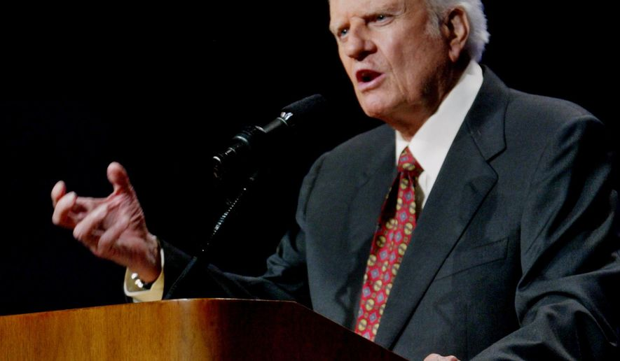 FILE - In this June 12, 2003 file photo, the Rev. Billy Graham preaches in Oklahoma City, Okla. Graham, who died Wednesday, Feb. 21, 2018, at his home in North Carolina's mountains at age 99, reached hundreds of millions of listeners around the world with his rallies and his pioneering use of television. Graham's body will be brought to his hometown of Charlotte on Saturday, Feb. 24, as part of a procession expected to draw crowds of well-wishers. (AP Photo/Sue Ogrocki, File)