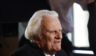FILE - In this Dec. 20, 2010 file photo, evangelist Billy Graham, 92, speaks during an interview at the Billy Graham Evangelistic Association headquarters in Charlotte, N.C. Graham, who died Wednesday, Feb. 21, 2018, at his home in North Carolina's mountains at age 99, reached hundreds of millions of listeners around the world with his rallies and his pioneering use of television. Graham's body will be brought to his hometown of Charlotte on Saturday, Feb. 24, as part of a procession expected to draw crowds of well-wishers. (AP Photo/Nell Redmond, File)