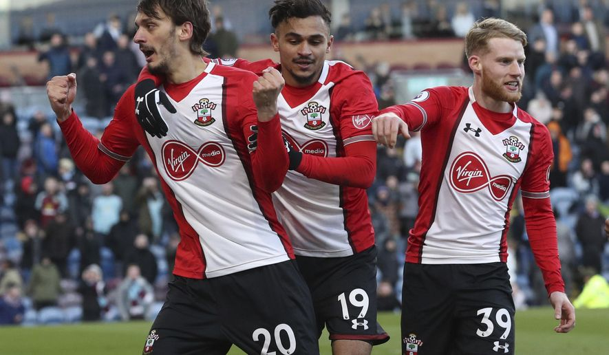Southampton's Manolo Gabbiadini, left, celebrates after scoring his side's first goal during the Premier League soccer match between Burnley and Southampton, at Turf Moor, Burnley, England, Saturday, Feb. 24, 2018. (Martin Rickett/PA via AP)