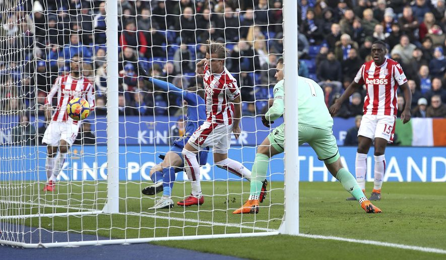 Stoke City goalkeeper Jack Butland, second right, scores an own goal during the English Premier League soccer match, Leicester City against Stoke City, at the King Power Stadium, Leicester, England, Saturday Feb. 24, 2018. (Nick Potts/PA via AP)