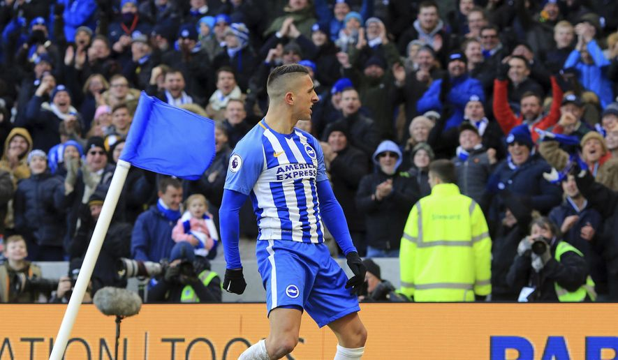 Brighton & Hove Albion's Anthony Knockaert celebrates scoring his side's third goal against Swansea City during their English Premier League soccer match at the AMEX Stadium in Brighton, England, Saturday Feb. 24, 2018. (Gareth Fuller/PA via AP)