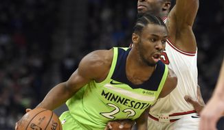 Minnesota Timberwolves' Andrew Wiggins (22) drives against Chicago Bulls' David Nwaba during the first quarter of an NBA basketball game on Saturday, Feb. 24, 2018, in Minneapolis. (AP Photo/Hannah Foslien)