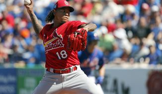 St. Louis Cardinals starting pitcher Carlos Martinez throws during the first inning of an exhibition spring training baseball game against the New York Mets, Saturday, Feb. 24, 2018, in Port St. Lucie, Fla. (AP Photo/Jeff Roberson)