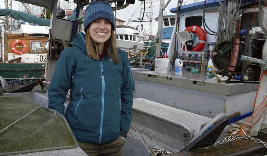 Fishing vessel deckhand Cathryn Klusmeier stands onboard the F/V I Gotta Thursday, Feb. 15, 2018, at ANB Harbor in Sitka, Alaska. (James Poulson/Daily Sitka Sentinel via AP)