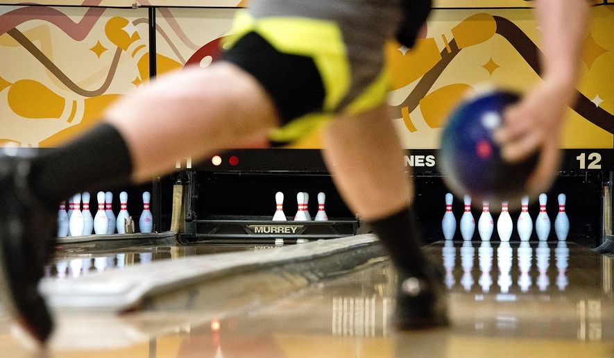 In a Tuesday, Jan. 9, 2018 photo, Morningside College bowling team member Tanner Hansel rolls the ball during an team practice at Rush Lanes in Sioux City, Iowa. (Tim Hynds/Sioux City Journal via AP)