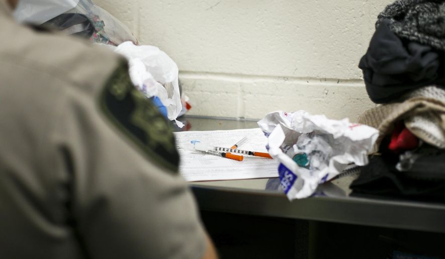 In this June 23, 2017, photo, deputies find needles and drug paraphernalia on an incoming detainee at the Marion County Jail. Meth-related deaths are higher now than they've ever been in Oregon, far surpassing the rates seen at the height of the meth crisis in the mid-2000s. (Molly J. Smith/Statesman-Journal via AP)