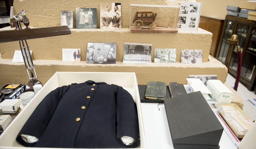 This Feb. 15, 2018, photo shows a number of artifacts, including a Civil War uniform, in the basement of the Rio Grande Depot, home of the Utah state historical offices in Salt Lake City. (Jeremy Harmon/The Salt Lake Tribune via AP)