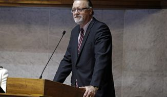 """FILE - In this Jan. 13, 2017 file photo, Senate President David C. Long, R-Fort Wayne, speaks at the Statehouse in Indianapolis. Long, the top Republican in the Indiana Senate opposes a payday lending bill that critics say would allow for predatory annual percentage rates as high as 222 percent. Long says he's """"not a big fan"""" of the bill, which cleared the House last month. (AP Photo/Michael Conroy)"""