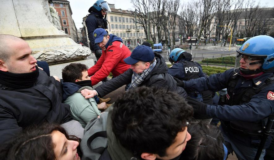 Police take on students during a demonstration in Milan, Italy, Saturday, Feb. 24, 2018. Thousands of police have been deployed for protests in Rome, Milan and other Italian cities tasked with preventing clashes during an election campaign that has increasingly been marked by violence. At least a dozen marches, rallies or other protests were underway or about to start in several cities Saturday, on the last weekend that political rallies are allowed before the March 4 elections. (Daniel Dal Zennaro/ANSA via AP)