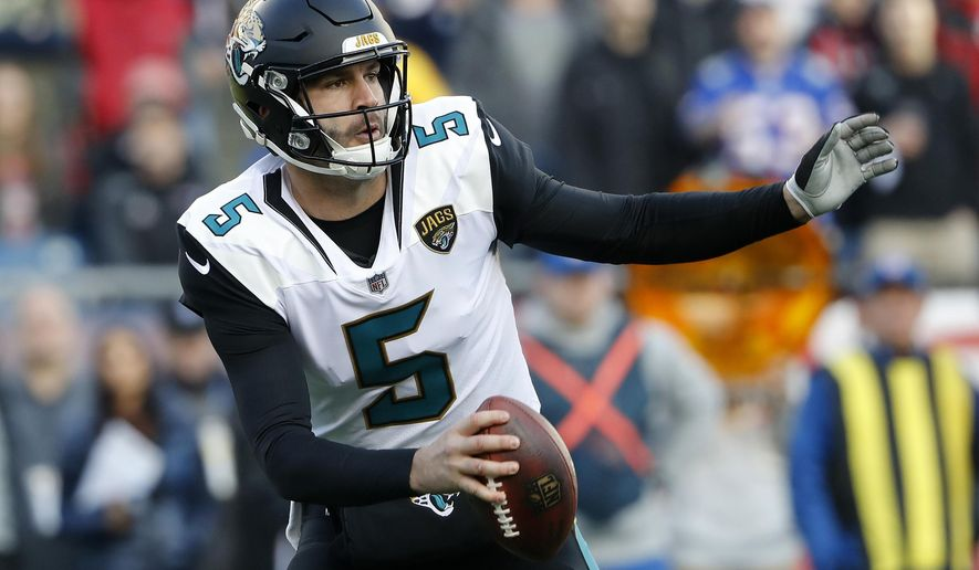 FILE - In this Jan. 21, 2018, file photo, Jacksonville Jaguars quarterback Blake Bortles scrambles against the New England Patriots during the AFC championship NFL football game at Gillette Stadium in Foxborough, Mass. A person with knowledge of negotiations says the Jaguars are finalizing an extension that will keep Bortles under contract through 2020. The person spoke to The Associated Press on Saturday, Feb. 24, on the condition of anonymity because the deal has not been completed. (AP Photo/Winslow Townson, File)