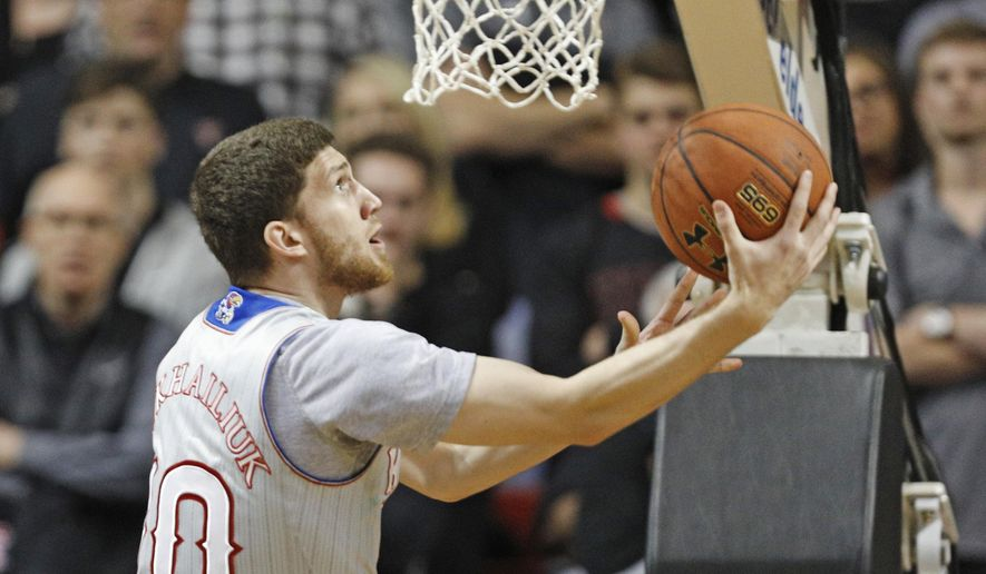 Kansas' Sviatoslav Mykhailiuk (10) lays up the ball during the first half of an NCAA college basketball game against Texas Tech, Saturday, Feb. 24, 2018, in Lubbock, Texas. (AP Photo/Brad Tollefson)
