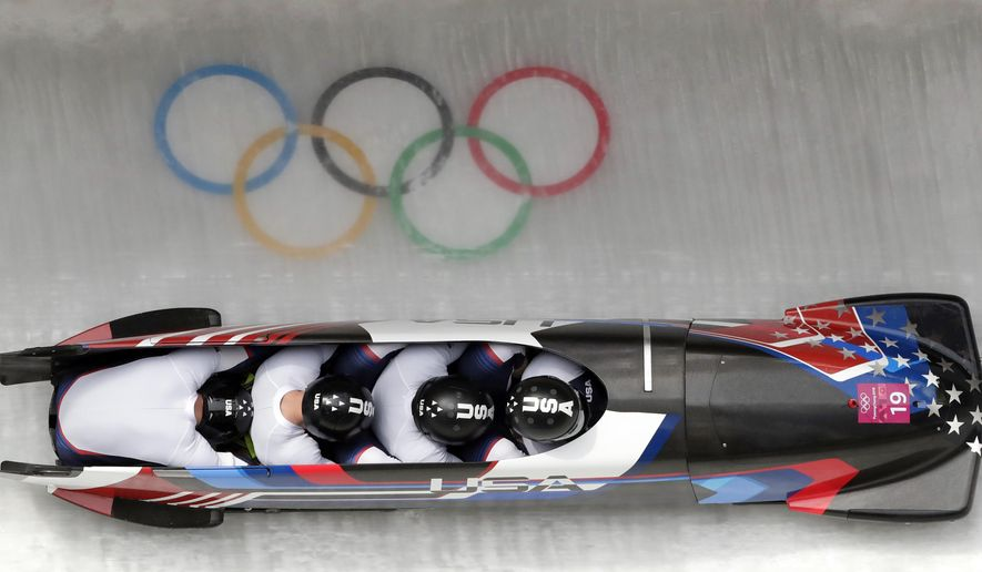 Driver Justin Olsen, Christopher Fogt, Carlo Valdes and Nathan Weber of the United States take a curve in the second heat of the four-man bobsled competition at the 2018 Winter Olympics in Pyeongchang, South Korea, Saturday, Feb. 24, 2018. (AP Photo/Michael Sohn)